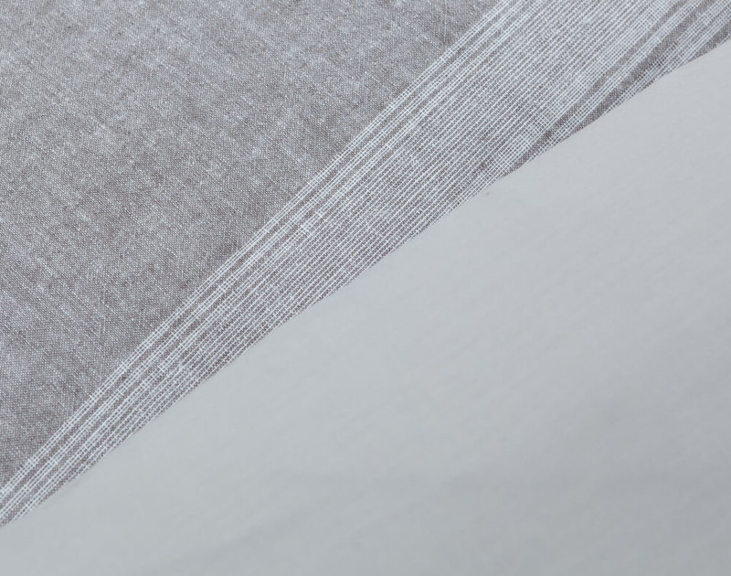 Side by side view of front and reverse of the Linen Blend Duvet Cover Set in Nathan, a soft grey horizontal striped pattern that reverses to a light grey.