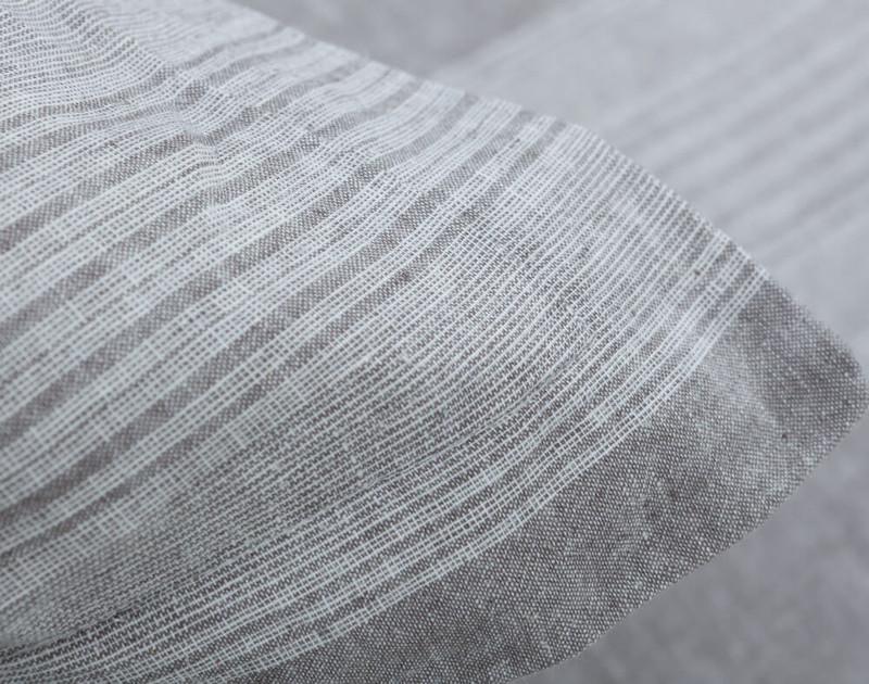 Close up of textured linen blend on pillow sham.