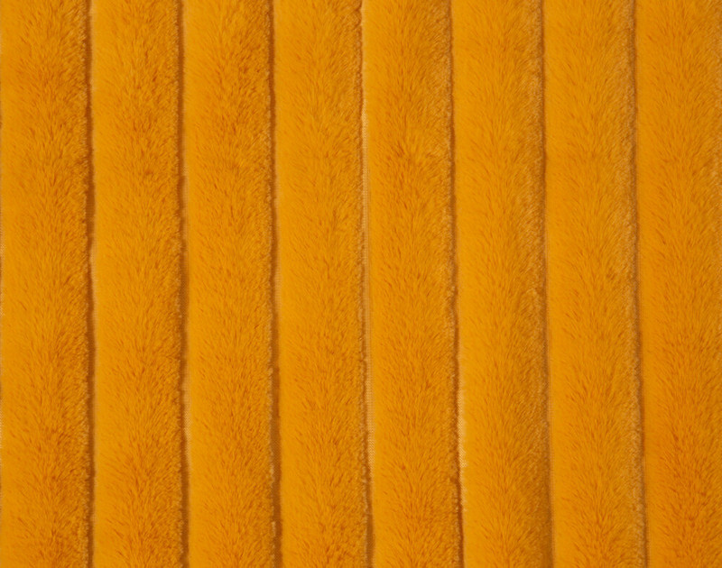 Close up of channels in the Ribbed Faux Fur Throw in Honey, a warm orange.