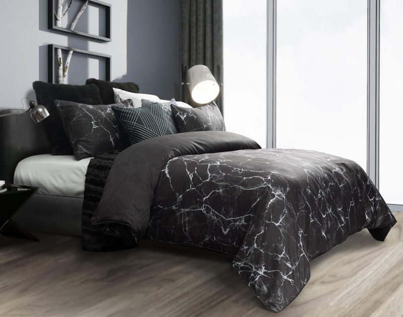 Inkstone Duvet Cover features a marbled print on a black background.