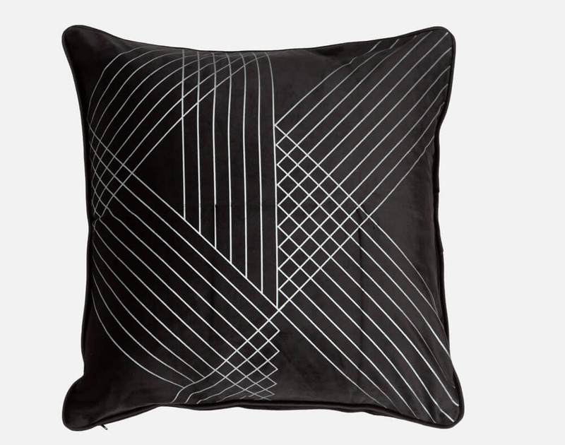 Inkstone Square cushion cover features a metallic silver lined design on black velvet.
