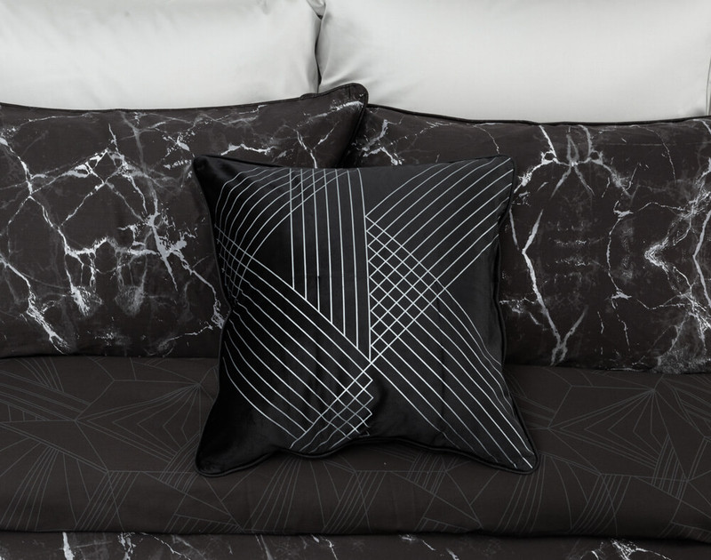 Inkstone Square Cushion Cover in black pictured with duvet cover and pillow shams.