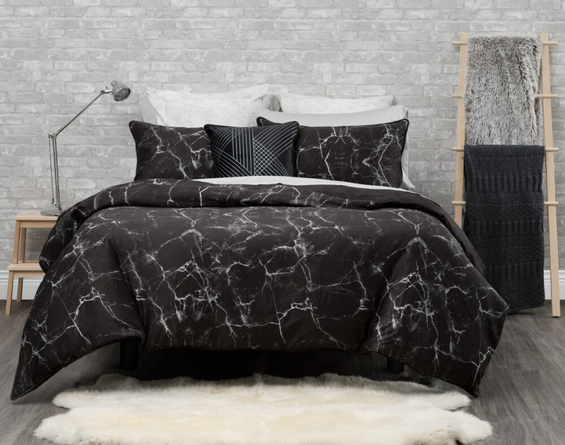 Inkstone Bedding Collection features a marbled print on a black background.