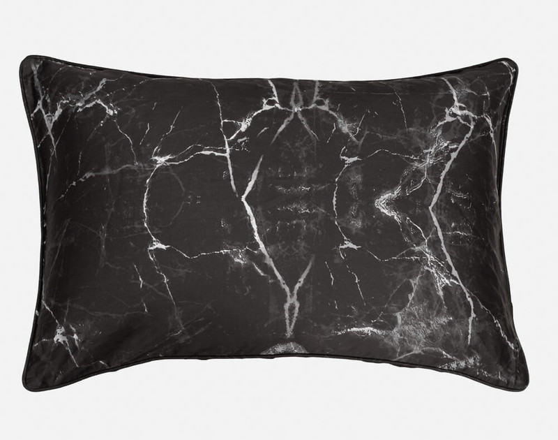 Inkstone Pillow Sham features a marbled print on a black background.