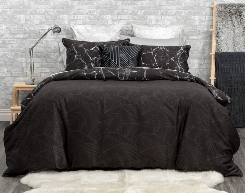 Inkstone Duvet Cover reverses to a silver geometric print on a black background.