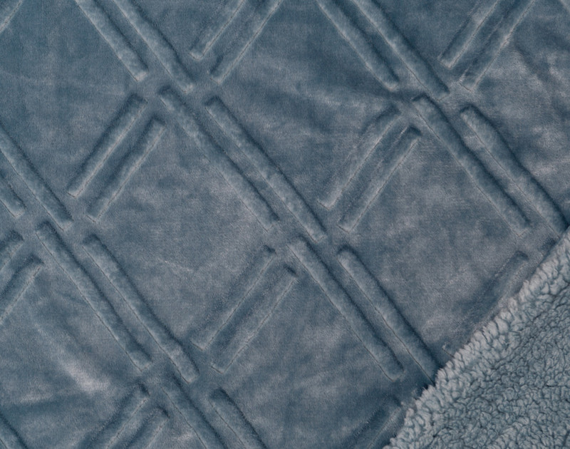 Close up of pattern and sherpa reverse of Diamond Etched Throw in Tidewater, a soft blue