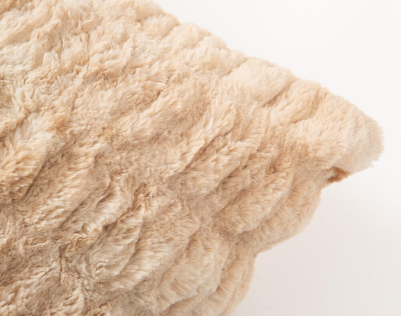Carved Faux Fur Euro Sham in Caramel, a medium beige with orange undertones, corner close-up