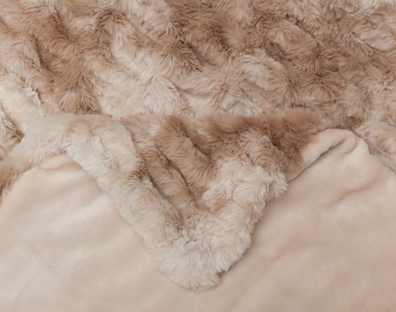 Close up of seams on Carved Faux Fur Throw in Caramel.