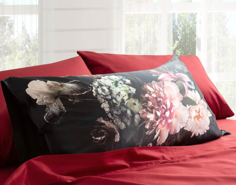 100% Mulberry Silk Pillowcase in Midnight Floral on bed.