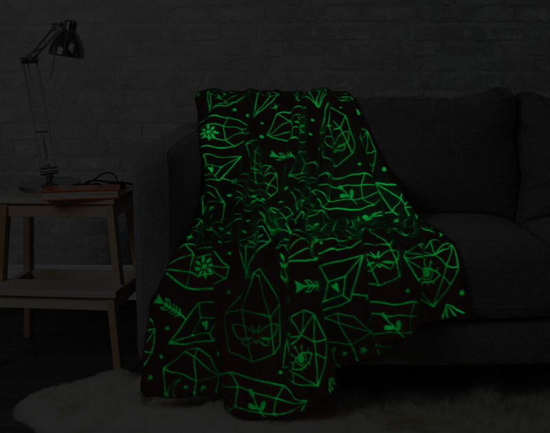 Crystal Glow in the Dark Throw pictured in the dark with glow in the dark portions lit up.