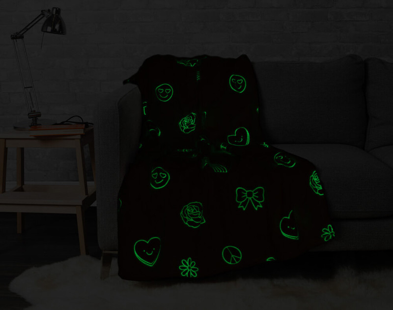 Shine Bright Glow in the Dark Throw pictured in the dark with glow in the dark portions lit up.