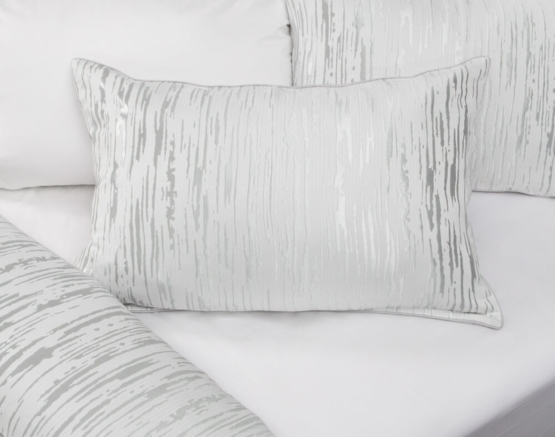 Cloudburst Pillow Sham pictured with Eucalyptus Luxe Sheet Set in White.