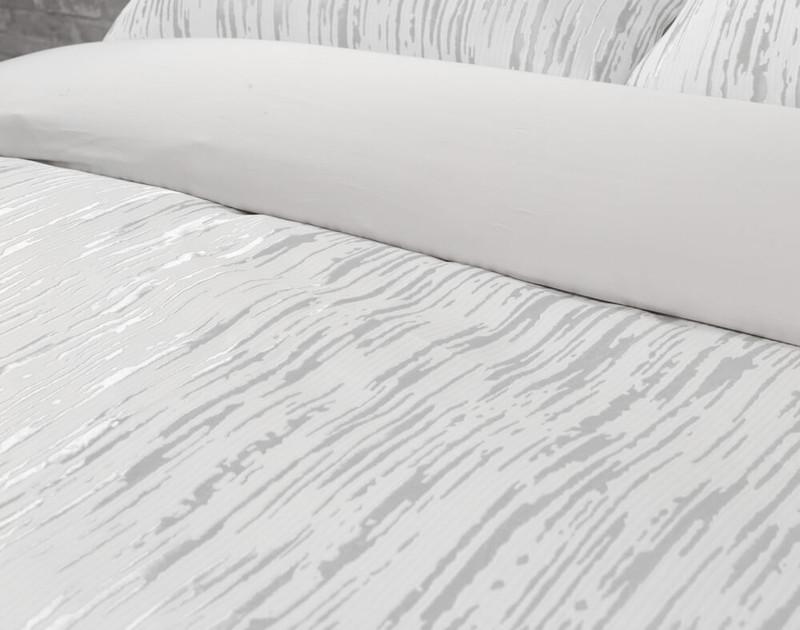 Cloudburst Duvet Cover folded over to reveal light silver reverse.