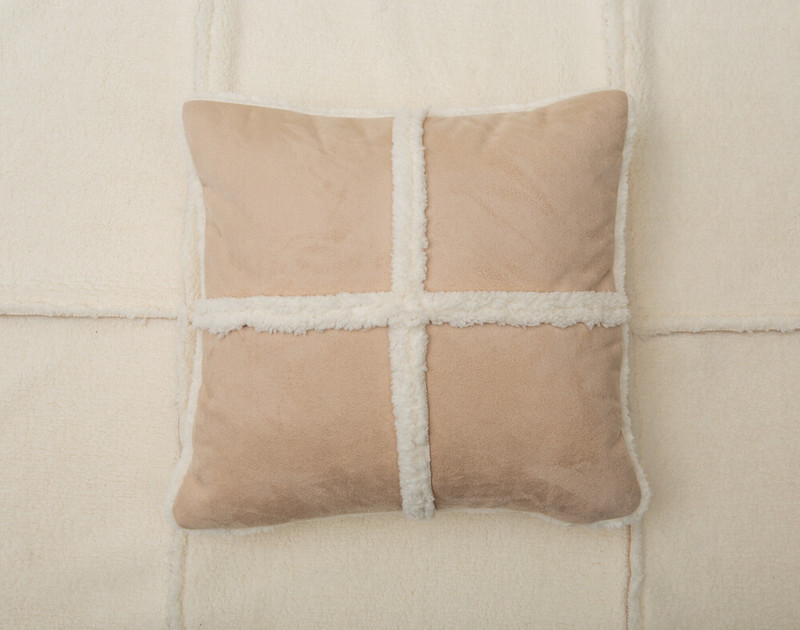 Windowpane Shearling Square Cushion pictured with BeechBliss Sheet Set in Cloud.