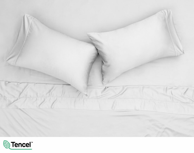 Overhead image of 300TC TENCEL™ Lyocell Blend Sheet Set and 2 pillowcases in Mist, a light silver grey colour