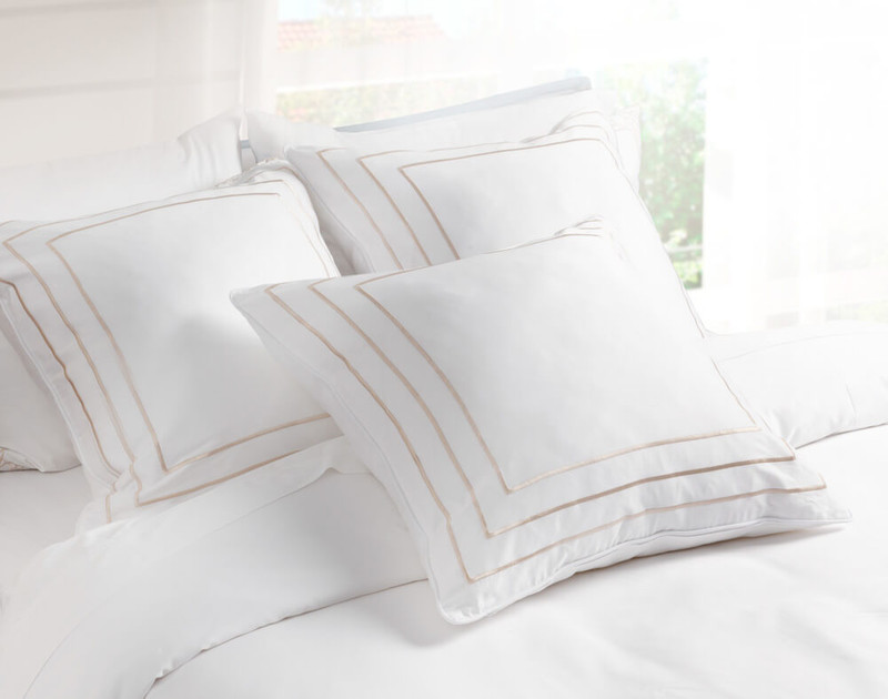 Three Delano Euro Shams on Bed