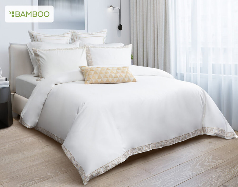 Front view of the Delano Bedding Collection and its white design that comes embellished with subtle gold satin-stitch embroidered details.
