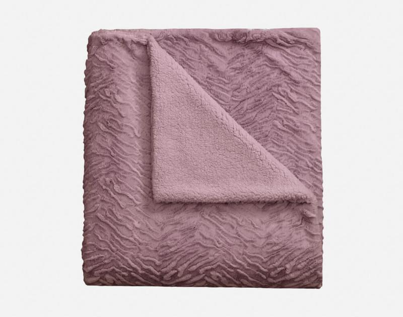 Folded view of Rabbit Plush Throw in Purple Haze.