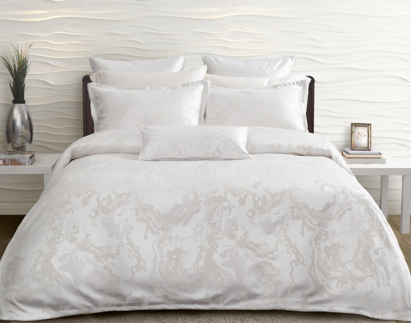 Travertine Duvet Cover features a stone-inspired jacquard in soft white, silver, and cream, and is finished with a 1-inch flange.