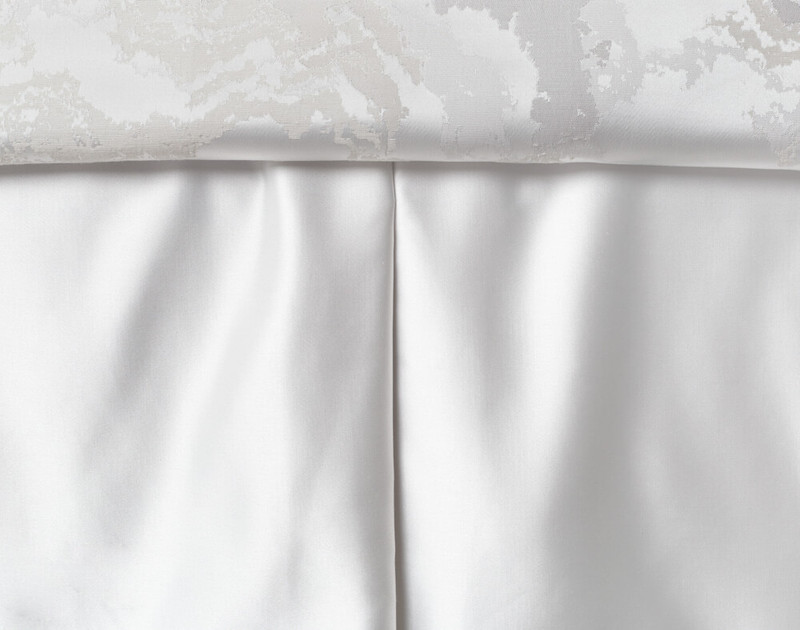 Travertine Bedskirt features pleates and is fabricated from a white 300TC cotton jacquard blend.