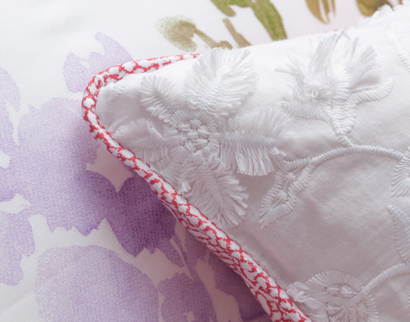 Close up of coral pink piped edges on Calypso Boudoir Cushion Cover.