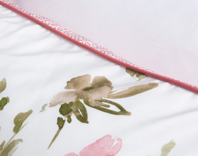 Close up of coral pink piped edges on Calypso Pillow Sham.