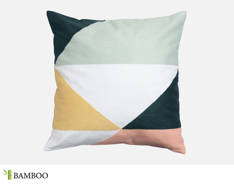 The Estelle Square Cushion Cover has a playful colour-blocked chain stitch embroidery in teal, aqua, gold and blush.