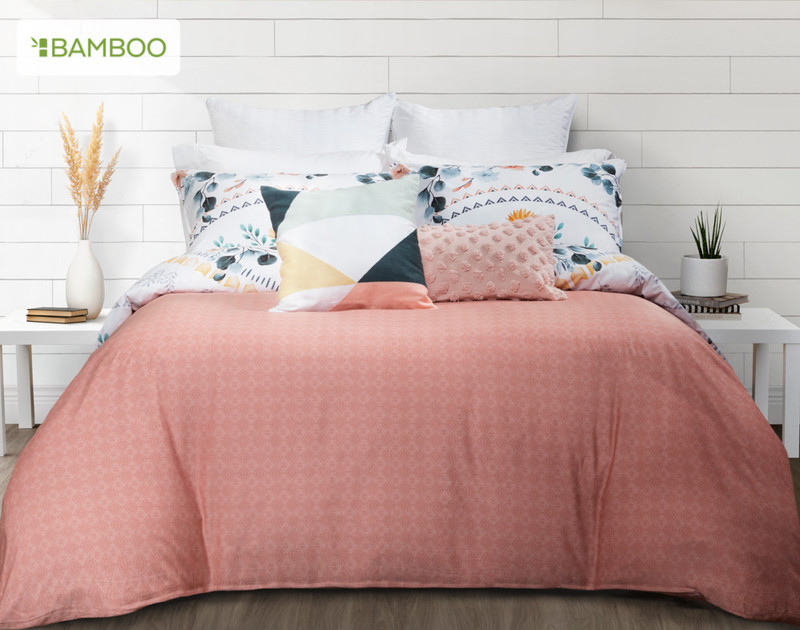 Estelle Duvet Cover reverses to a textured diamond pattern in shades of terracotta.