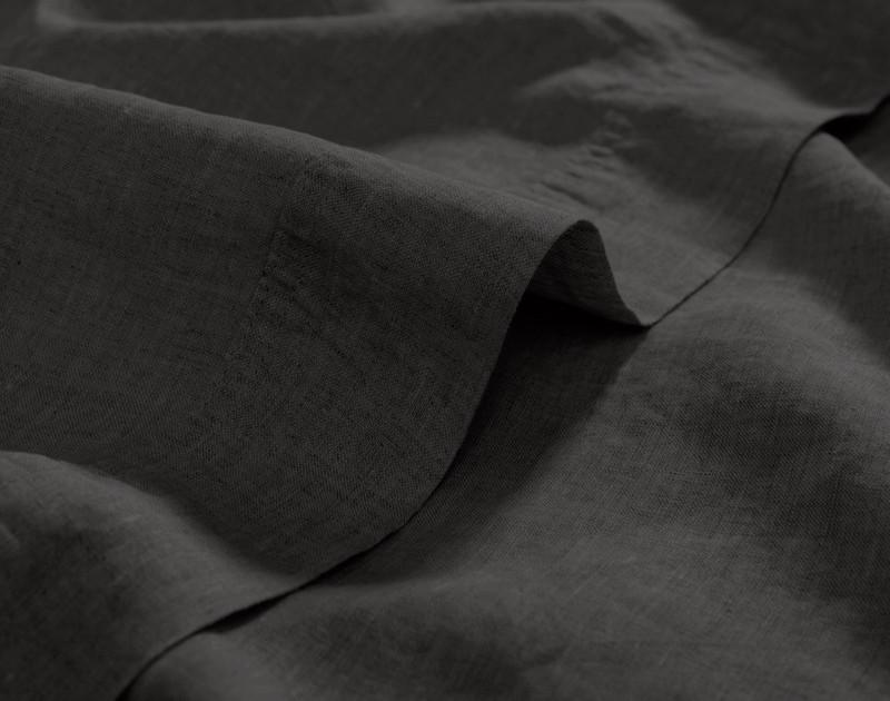 Vintage Washed European Linen Flat Sheet in Magnet, a dark grey, hem view.