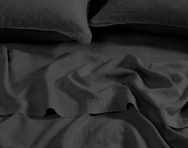 Vintage Washed European Linen Flat Sheet in Magnet, a dark grey, close-up view.