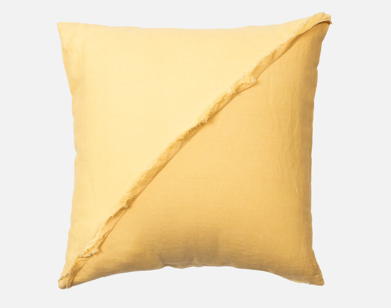 The Moorea Square Cushion Cover in 100% linen fabric features 2 tones of yellow joined together in a dynamic diagonal with a relaxed frayed edge.