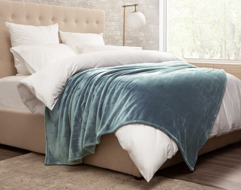 Cashmere Touch Fleece Blanket in Tidewater, side view.