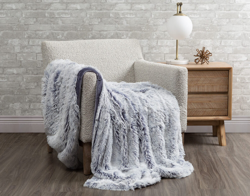 Frosted Shaggy Throw in Denim, a pale blue.