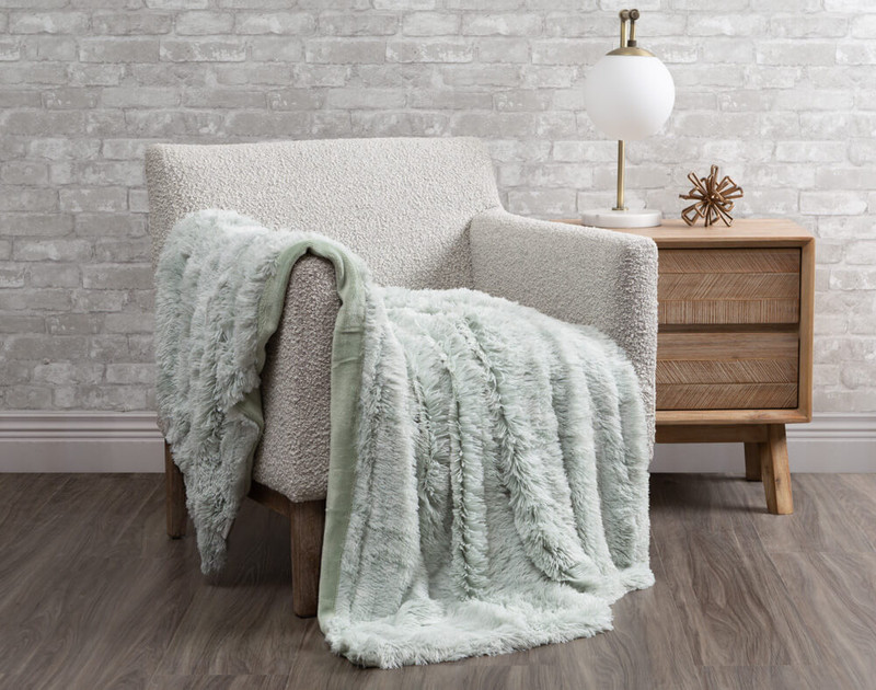Frosted Shaggy Throw in Harbour, a light, minty green.