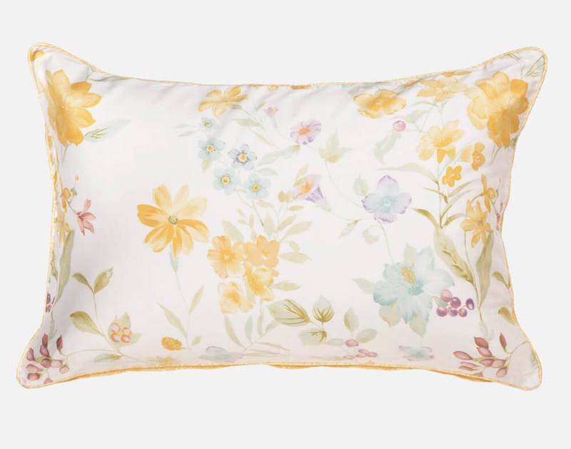 Alyssa Pillow Sham features wild yellow dahlias and daisies against a white backdrop.
