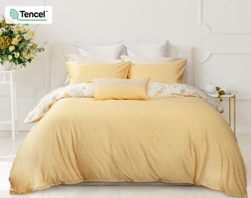 Alyssa Duvet Cover reverses to a mini tone-on-tone yellow leaf pattern.