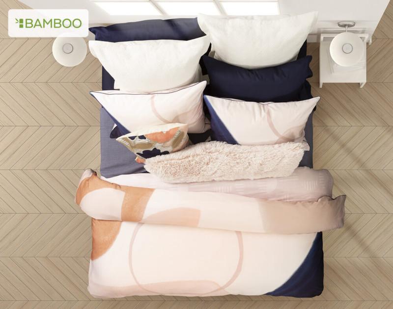 Styled overhead shot of Memphis Duvet Cover, featuring Camellia pink lumbar pillow.