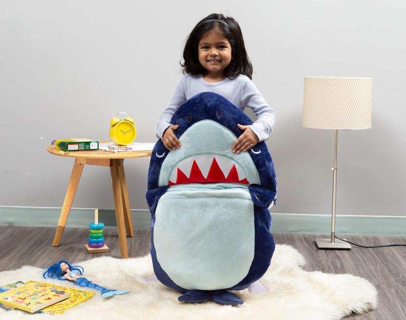 Child holding folded up sleeping bag