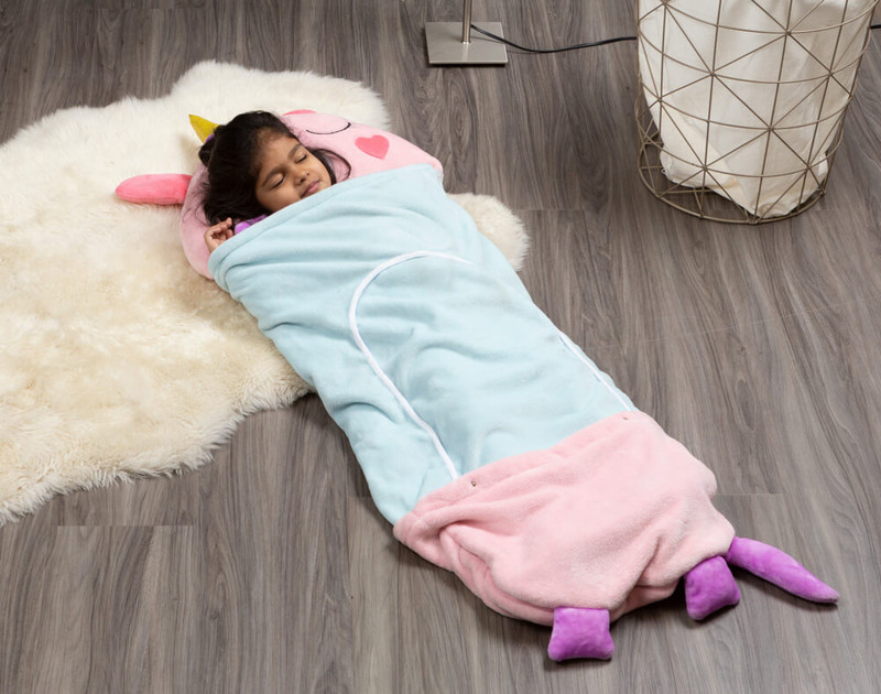 Child sleeping in flannel sleeping bag.