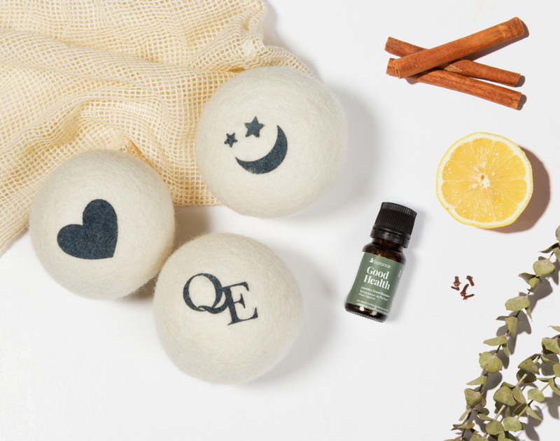 Linen Love Wool Dryer Balls, and Good Health scent booster next to its ingredients of lemon, cinnamon, and thyme