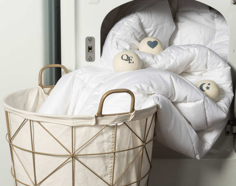 Linen Love Wool Dryer Balls wrapped in a duvet coming out of the dryer