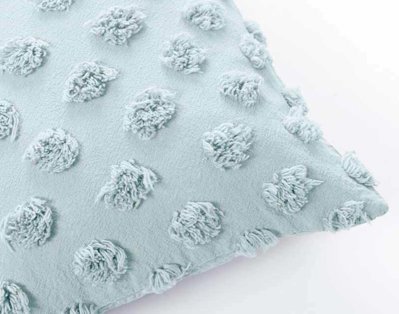 Close up of Tufted Boudoir Cushion Cover in Harbour, a pale-blue green.