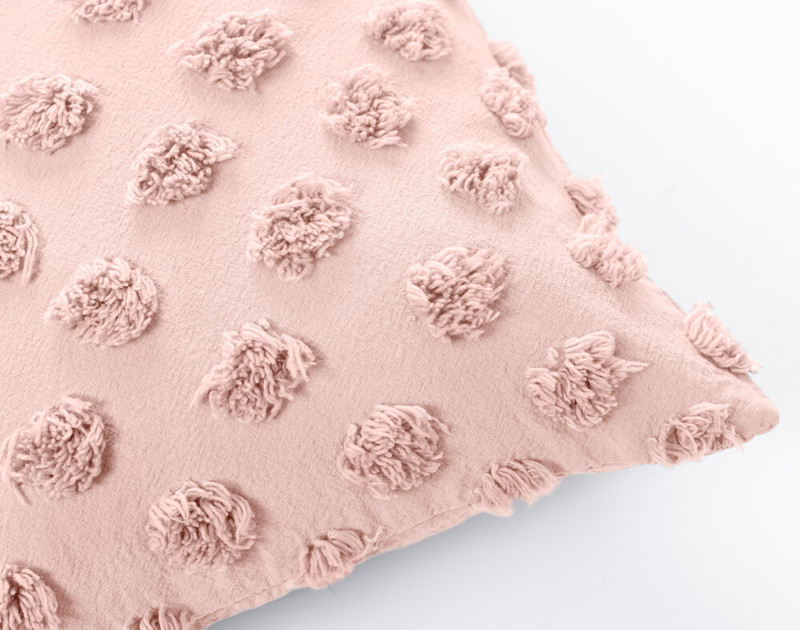 Close up of Tufted Boudoir Cushion Cover in Rose Smoke, a soft pastel pink.