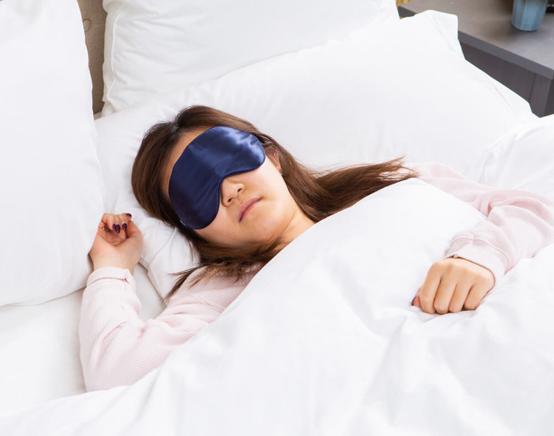 100%  Silk Eye Mask in Navy, a deep blue.