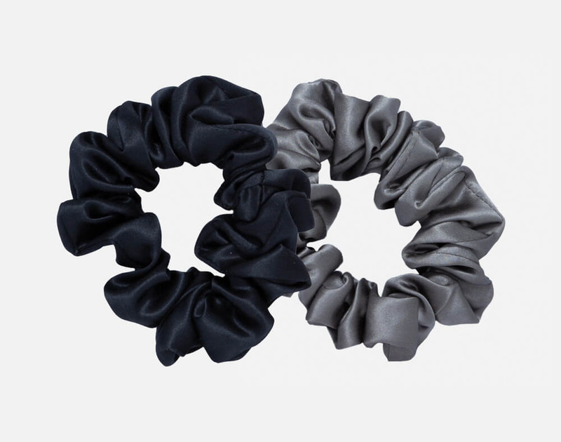 100% Mulberry silk scrunchies in black and pewter grey.