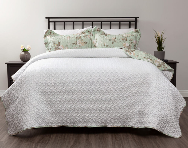 Gable coverlet set reverses to a solid white.