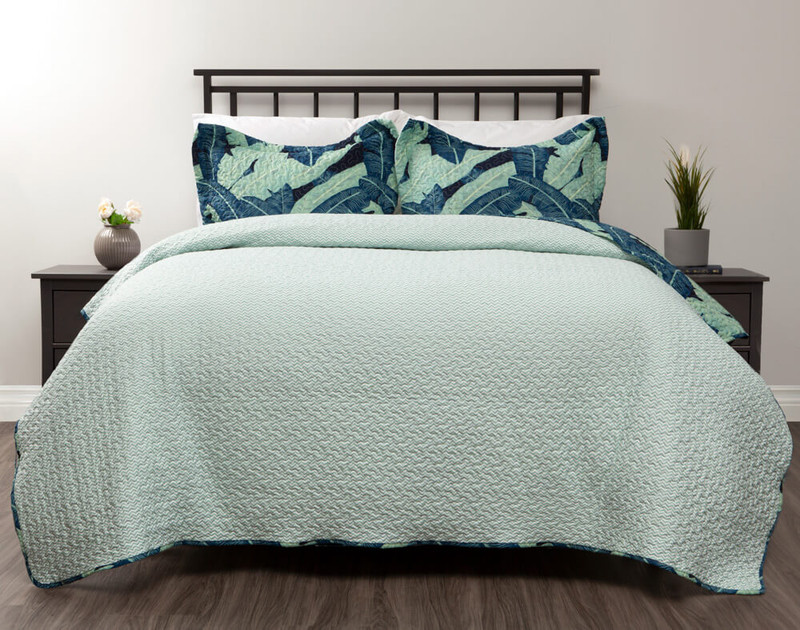 Reverses to a solid white with mint green zigzag print.