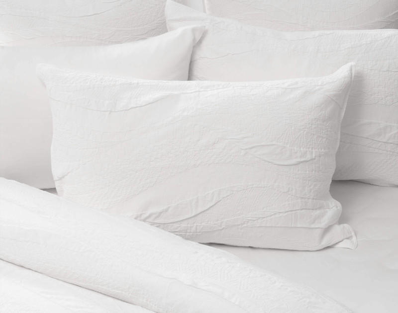 Anira Pillow Sham on bed.