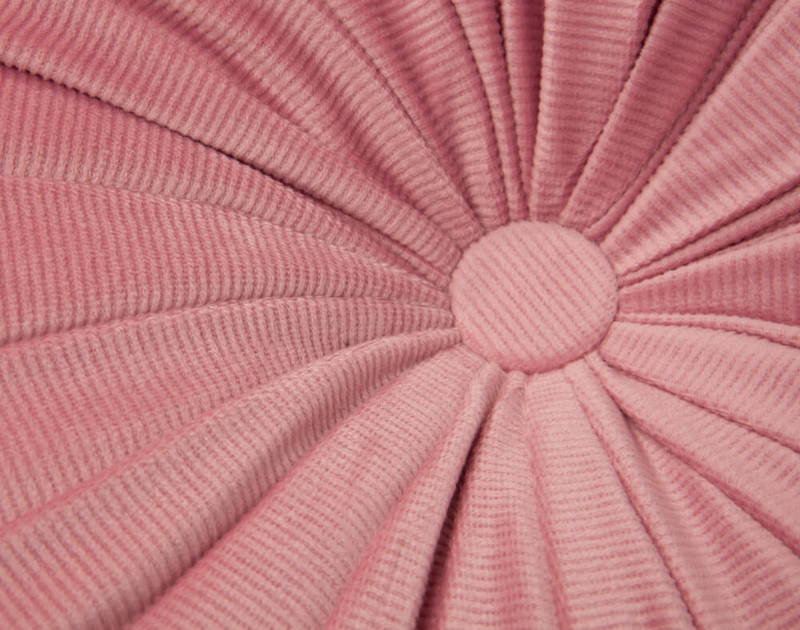 Close up of button detail on Round Corduroy Pillow.