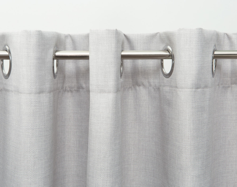 Hanging on curtain rod, front view.